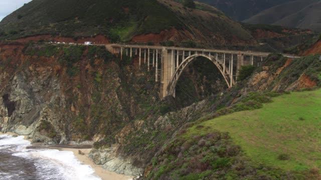 drone flight towards bixby creek bridge - bixby creek bridge stock videos & royalty-free footage