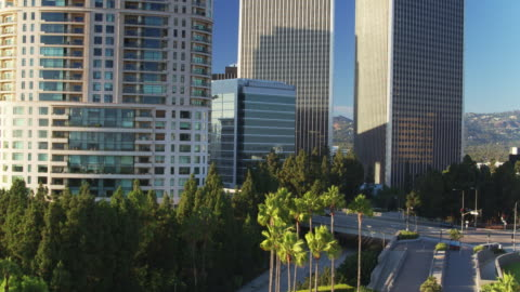 drone flight towards office towers in century city, los angeles - century city stock videos & royalty-free footage