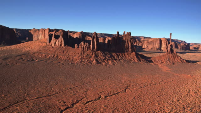 drone flight towards totem pole and yei bi chei, monument valley - utah stock videos & royalty-free footage