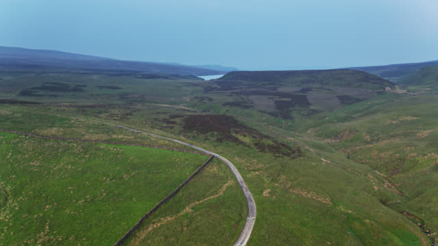 drone flight towards watersheddles reservoir, lancashire - aerial - reservoir stock videos and b-roll footage