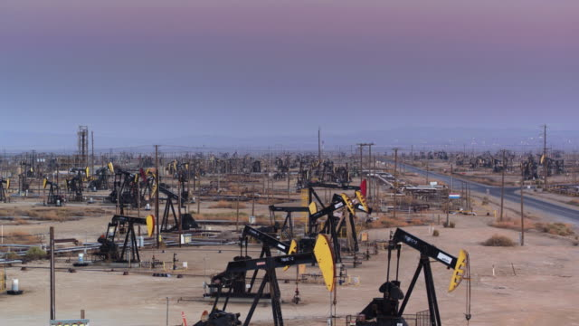 Drone Flight Up and Over Pump Jacks at South Belridge Oil Field in Kern County, California