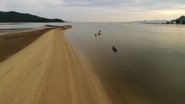 Drone fly on top view, they play kayak on the beach Krabi, THAILAND.