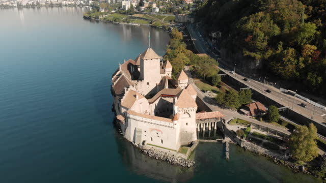 drone fly over shot of the famous chillon castle in lake geneva, switzerland - aircraft point of view stock videos & royalty-free footage