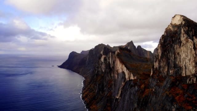 drone flying above majestic fjords on senja island - nature reserve stock videos & royalty-free footage