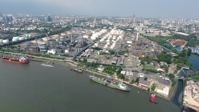 drone flying, aerial view beautiful refinery oil with river reflection, - oil rig supply ship stock videos and b-roll footage