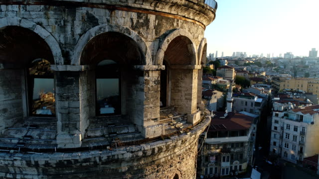 drone flying  around the galata tower at sunrise in istanbul - close-up shot - bosphorus stock videos & royalty-free footage