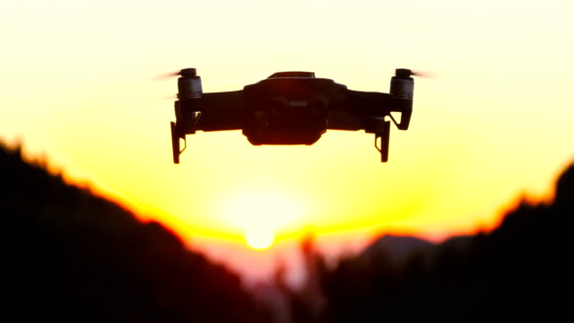 drone flying at sunset - drone stock videos & royalty-free footage