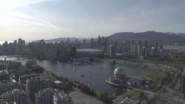 drone flying away from downtown vancouver   4k - british columbia stock videos & royalty-free footage