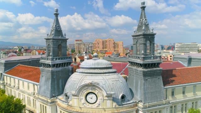 stockvideo's en b-roll-footage met drone vliegen tussen twee torens in het centrum van district sofia, bulgarije - eastern european culture