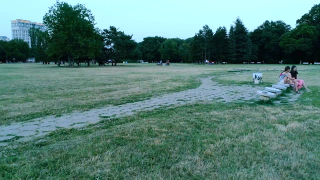 drone flying low in city park near sunset - low stock videos and b-roll footage