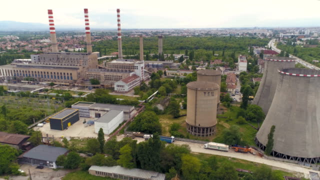 drone flying near power plant in the city - bulgaria stock videos & royalty-free footage