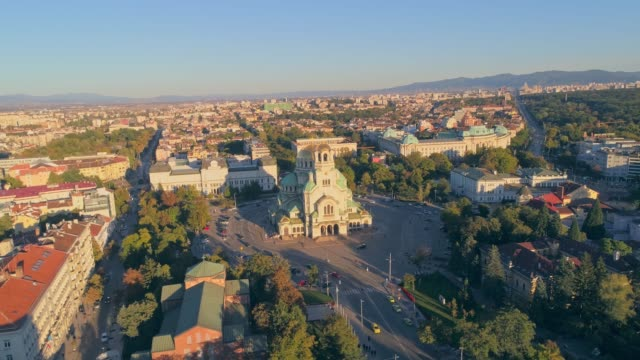 drone flying orbiting around alexander nevski cathedral in sofia, bulgaria - bulgaria video stock e b–roll