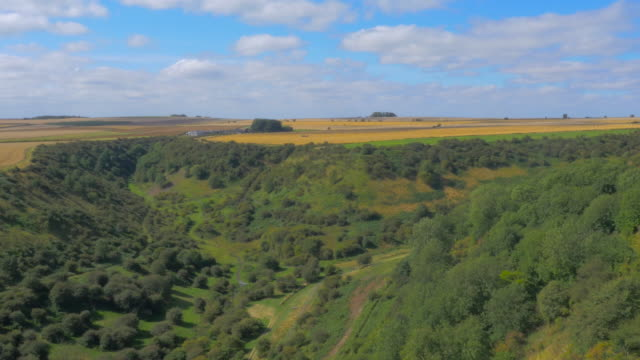 Drone flying over a green valley on the Yorkshire Moors, UK