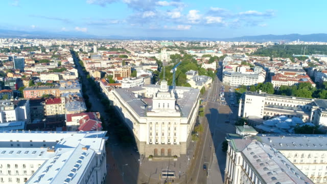 drone flying over beautiful old buildings in the city center in sofia, bulgaria - bulgaria video stock e b–roll