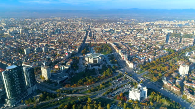 drone flying over big capital city - bulgaria stock videos & royalty-free footage