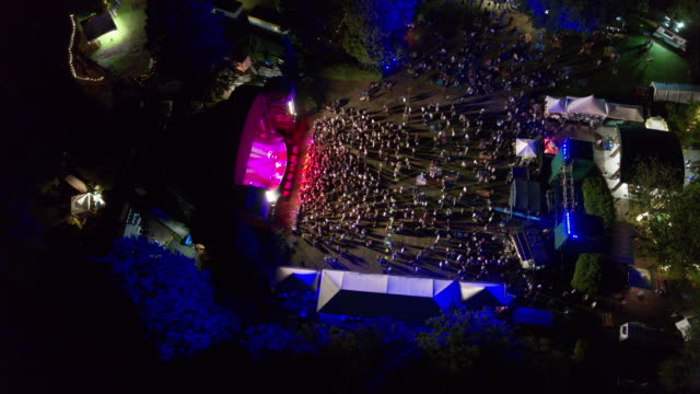 4k drone flying over concert at night - entertainment building stock videos & royalty-free footage