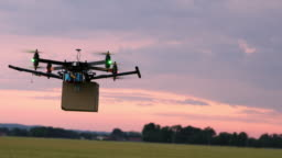 LS Drone flying over fields with a package at dusk