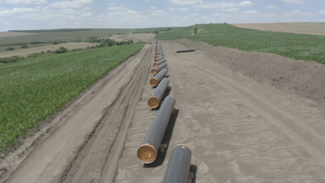 drone flying over gas pipeline construction. - pipeline stock videos & royalty-free footage