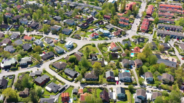 drone flying over hässelby villa community, and road, seen from air, stockholm - residential district stock videos & royalty-free footage