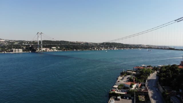 drone flying over istanbul, bosphorus - july 15 martyrs' bridge stock videos & royalty-free footage