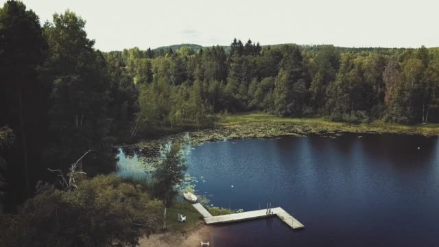 drone flying over lake - jetty stock videos & royalty-free footage