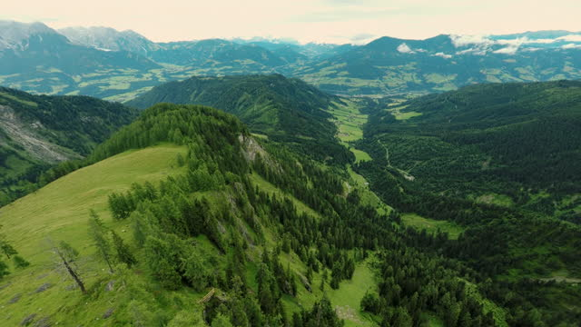 drone flying over of a scenic mountain ridge in the austrian alps - traditionally austrian stock videos & royalty-free footage