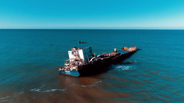 drone flying over oil spilling ship wreck - dji mavic on air - oil spill stock videos & royalty-free footage