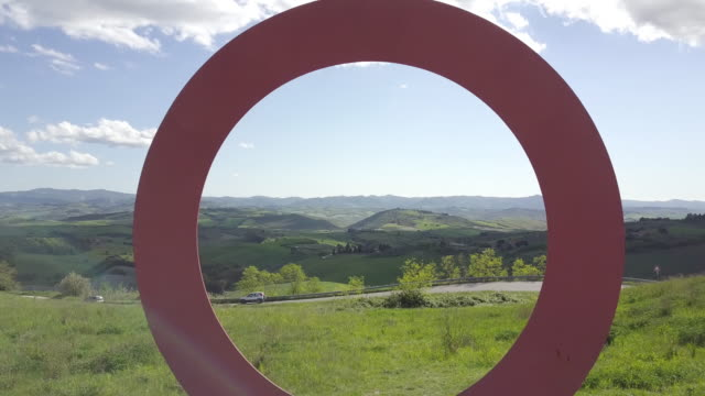 Drone flying through a circular monument near Volterra, Tuscany, Italy