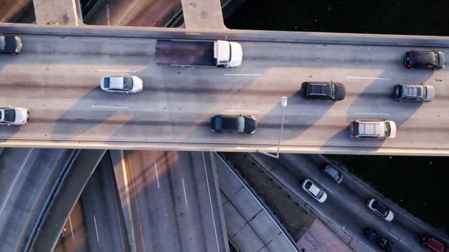 drone following freeway traffic - richtung stock-videos und b-roll-filmmaterial