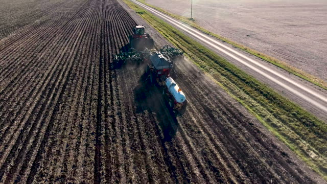 drone following planter - tractor stock videos & royalty-free footage
