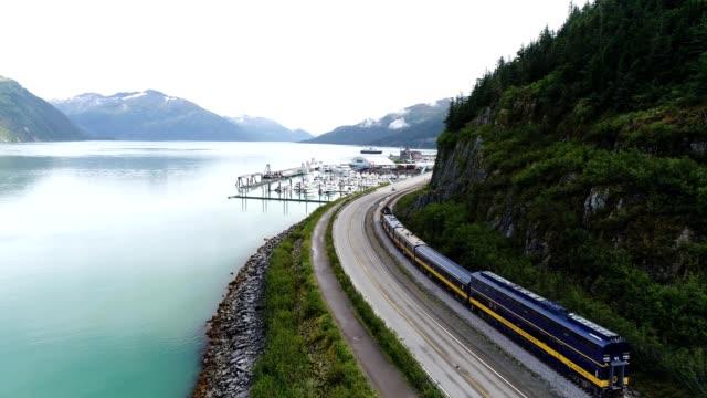 a drone follows an alaska railroad into whittier alaska - prince william stock videos & royalty-free footage