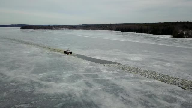 a drone follows an ice breaker on the kennebec river in bath maine - kennebec river stock videos & royalty-free footage