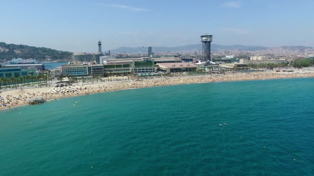 Drone Footage above Sant Sebastia Beach in Barcelona, Spain