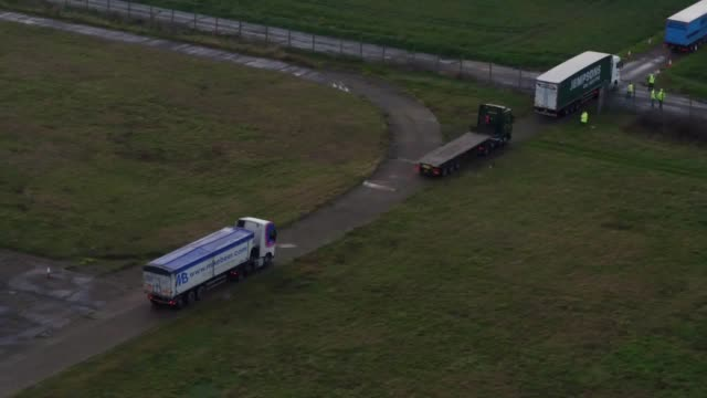 stockvideo's en b-roll-footage met drone footage as lorries leave manston airport near ramsgate in kent to begin the government's first major test of its plans for uk border disruption... - start  en landingsbaan