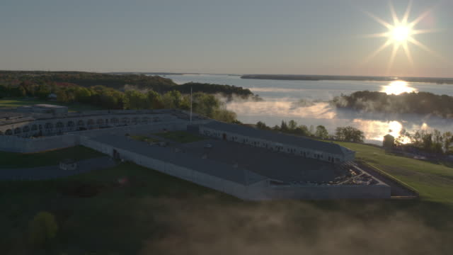 Drone footage at Fort Henry at sunrise with fog