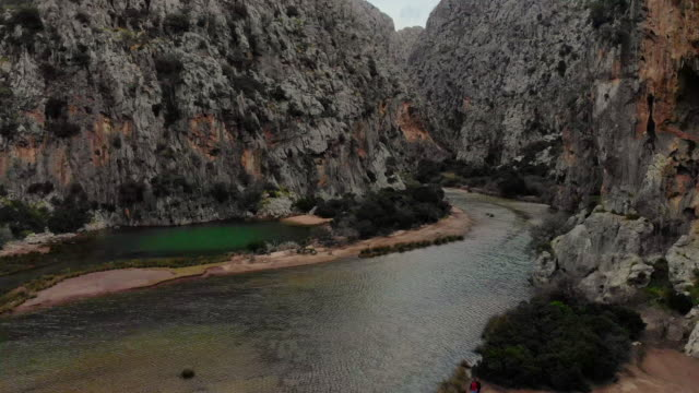 drone footage flying inside canyon with river in the mallorca island. - canyon stock videos & royalty-free footage