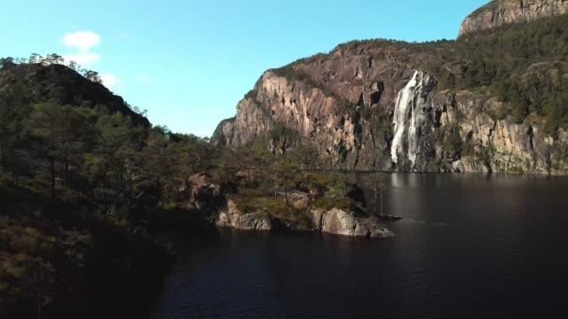 drone footage - norwegian waterfall - cliff video stock e b–roll