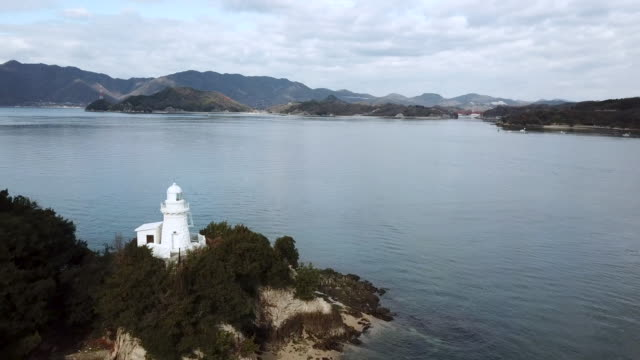 drone footage of a lighthouse in western japan - nishiseto expressway stock videos & royalty-free footage