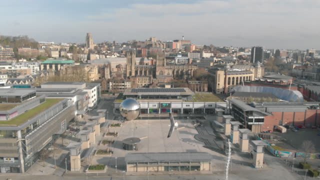 drone footage of a near empty millennium square during the 2020 uk government lockdown, coronavirus / covid-19 pandemic, in bristol, uk, illustrating... - city stock videos & royalty-free footage