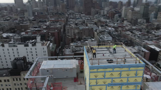 drone footage of a new york city skyscraper under construction - engineering stock videos & royalty-free footage