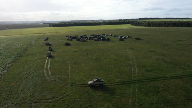 drone footage of a patrol of foxhound 4x4 lppv from the royal anglian regiment returning to the uk task group's temporary camp within an encircling... - foxhound stock videos & royalty-free footage