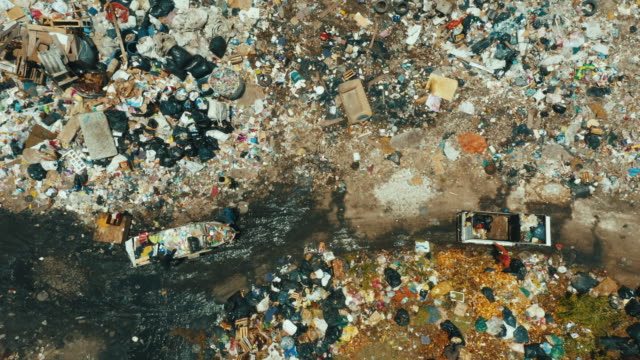 drone footage of a public landfill or garbage dump - rubbish dump stock videos & royalty-free footage