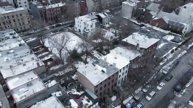 stockvideo's en b-roll-footage met drone footage of a snow covered brooklyn - stadswoning