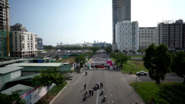 drone footage of a sport event - color me run - in saigon, vietnam - vietnam stock videos & royalty-free footage