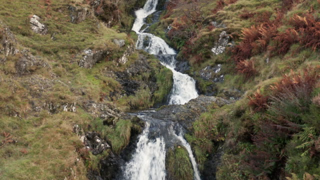 drone footage of a waterfall in rural south west scotland - johnfscott stock videos & royalty-free footage