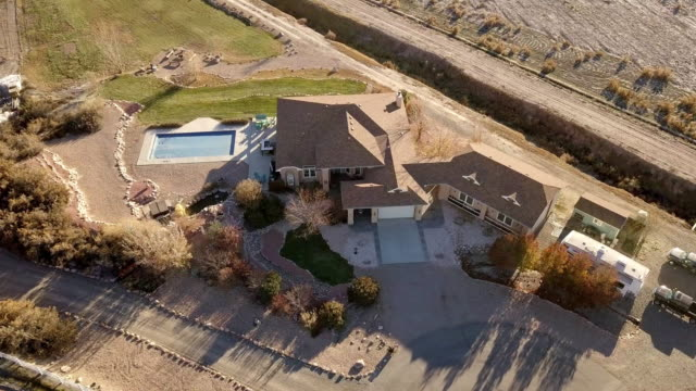 drone footage of an executive home in a rural, farm setting - ranch home stock videos & royalty-free footage