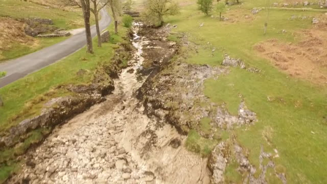 drone footage of an exposed riverbed caused by drought in the yorkshire dales, uk - drought stock videos & royalty-free footage