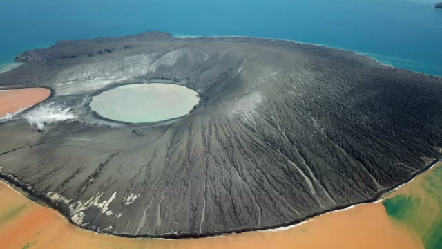 drone footage of anak krakatau volcano in indonesia after a major collapse and eruption caused a huge tsunami on 22nd december 2018 - indonesia volcano stock videos & royalty-free footage