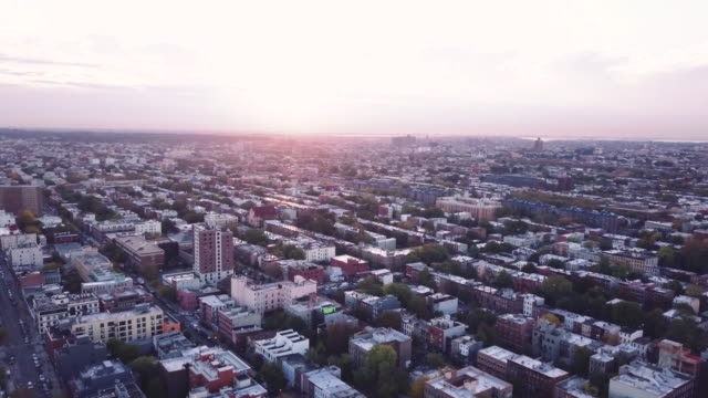 drone footage of brooklyn at sunrise. - row house stock videos & royalty-free footage
