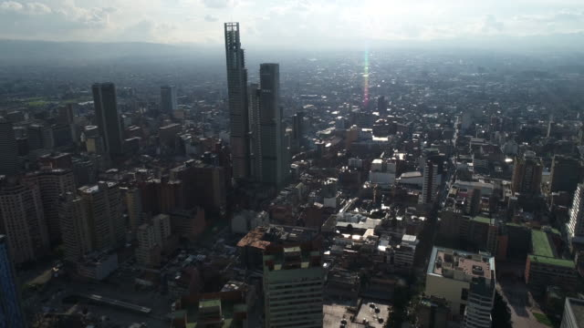 Drone footage of buildings in city on sunny day, Bogota, Colombia